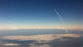 Space shuttle launch, viewed from an airplane